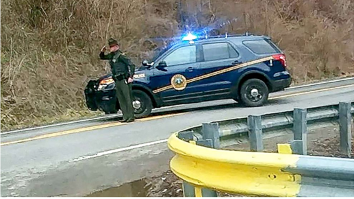 WVSP Trooper saluting funeral